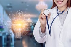 Healthy technology concept : Young Asian woman doctor Royalty Free Stock Photos