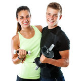 Healthy Teen Couple With Weights. Royalty Free Stock Photos