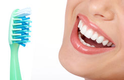 Healthy teeth. Smiling  young woman with healthy teeth and a tooth-brush Stock Image