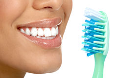 Healthy teeth. Smiling  young woman with healthy teeth and a tooth-brush Royalty Free Stock Photo