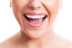 Healthy teeth. Closeup of the face of a young woman with healthy white teeth, isolated against white background Stock Image