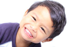 Healthy teeth. A boy showing his healthy teeth (on white background Stock Photography