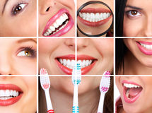 Healthy teeth. Smiling  young woman with healthy teeth holding a tooth-brush Stock Photo