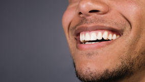Healthy teeth of a male as he smiles at something, space for text Royalty Free Stock Image