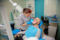 Healthy teeth patient at dentist office dental caries prevention Royalty Free Stock Photo
