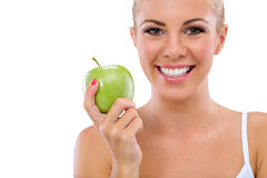 Healthy teeth. Smiling woman with healthy teeth holding green apple Stock Photo