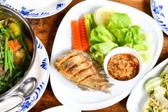 Healthy Thai food choices. Mushroom chili paste with salted fried fish and fresh veggies. Thai salad Stock Photography