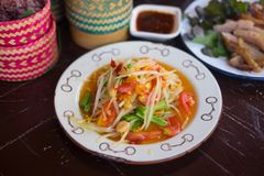 Healthy of Thai green papaya salad. Thai gourmet : healthy of Thai green papaya salad top view or Som Tum. Som Tum is original local food from the Northeast of Stock Photo