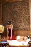 Healthy Thai Massage. Healthy traditional Thai massage on the back lags Stock Photo
