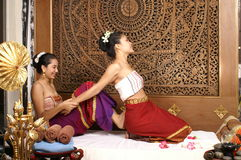 Healthy Thai Massage in thai traditional costume dress stock photography