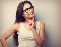 Healthy thinking woman in glasses looking up. Vintage closeup po Stock Photos