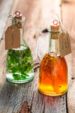 Healthy tincture as natural medicine. On old wooden table Stock Image