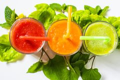 Healthy tomato, avocado and carrot smoothie in a glass  on white background. Healthy tomato, avocado and carrot smoothie in a glass  on white background Royalty Free Stock Images