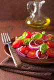Healthy tomato salad with onion basil olive oil and balsamic vin Stock Image