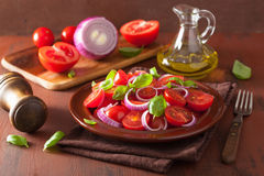Healthy tomato salad with onion basil olive oil and balsamic vin Royalty Free Stock Image