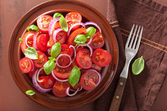 Healthy tomato salad with onion basil olive oil and balsamic vin Stock Photo