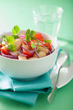 Healthy tomato salad with white beans onion coriander Royalty Free Stock Photos