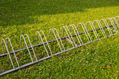 Healthy travel. Parking for bicycles on grass. Stock Photography