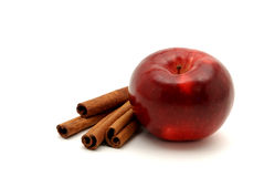 Healthy Treat. Shiny red apple and cinnamon sticks isolated on a white background Royalty Free Stock Photo