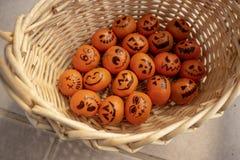 Healthy Trick or Treat snack Mandarin oranges Jack o Lantern faces stock images