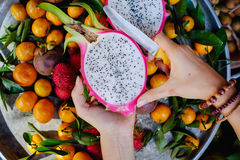 Healthy tropical fruit and ingredients from top view. Healthy mixed tropical fruit and ingredients with dragon fruit, pitaya, mangosteen, orange, rambutan from Royalty Free Stock Photos
