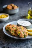 Tuna Fish cakes with green peas, corn and scallion served with sour cream dip. Healthy tuna Fish cakes with green peas, corn and scallion served with sour cream royalty free stock photography