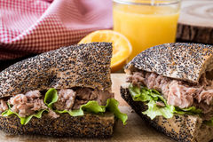 Healthy Tuna Fish Sandwich with orange juice in a poppy seeds bread. Stock Image