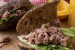 Healthy Tuna Fish Sandwich with orange juice in a poppy seeds bread. stock images