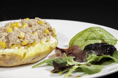 Healthy tuna sweetcorn baked potato meal with side salad Stock Images