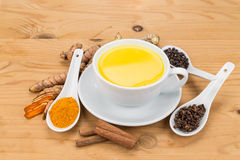 Healthy turmeric milk tea with ginger, cinnamon, cloves, black p Royalty Free Stock Images
