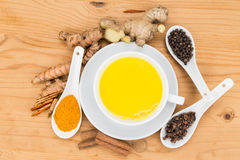 Healthy turmeric milk tea with ginger, cinnamon, cloves, black p Royalty Free Stock Photo