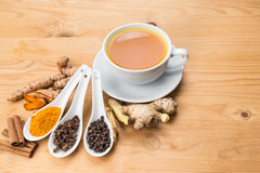 Healthy turmeric tea with black pepper, cinnamon, cloves and gin Stock Photo