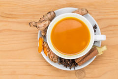 Healthy turmeric tea with black pepper, cinnamon, cloves and gin Royalty Free Stock Images