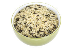 Healthy Uncooked Wild Rice served in Olive Dish or Bowl Royalty Free Stock Image