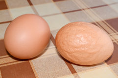 Healthy and unhealthy egg Stock Images