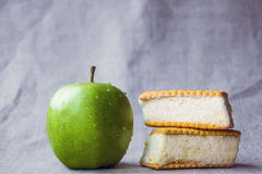 Healthy and unhealthy food on a fabric background Stock Photography