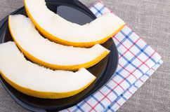 Healthy and useful dessert of sweet yellow melon slices Royalty Free Stock Photos