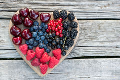 Healthy various fruits on heart. Diet abstract concept Royalty Free Stock Image