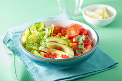 Healthy vegan avocado salad with tomatoes and sweetcorn Stock Image