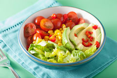 Healthy vegan avocado salad with tomatoes and sweetcorn Stock Images