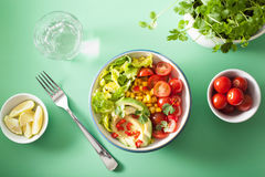 Healthy vegan avocado salad with tomatoes and sweetcorn Stock Photo
