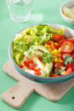 Healthy vegan avocado salad with tomatoes and sweetcorn Royalty Free Stock Image