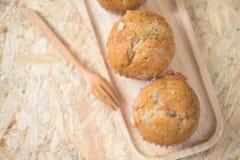 Healthy vegan banana muffins in wood pan stock photography