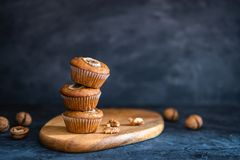 Healthy vegan banana walnut muffins. Side view, copy space royalty free stock images