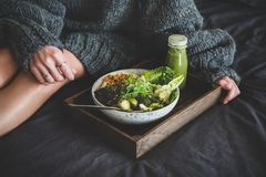 Healthy vegan bowl on tray and woman in sweater stock images