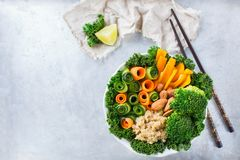 Healthy vegan buddha bowl with kale leaves and raw vegetables Stock Image