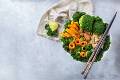 Healthy vegan buddha bowl with kale leaves and raw vegetables Royalty Free Stock Photos