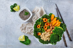 Healthy vegan buddha bowl with kale leaves and raw vegetables Stock Photography