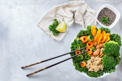 Healthy vegan buddha bowl with kale leaves and raw vegetables Royalty Free Stock Images