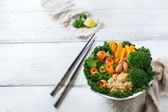 Healthy vegan buddha bowl with kale leaves and raw vegetables Stock Photos